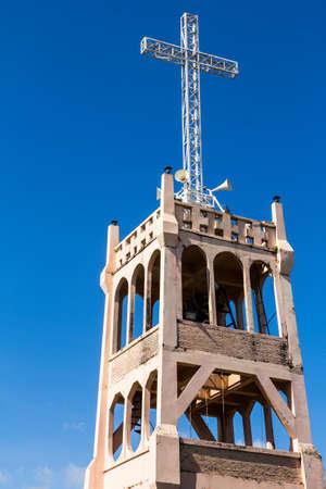 Cross on Belfry of Modern Christian Church Under Blue Sky