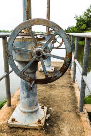 sluice: Old rusty floodgate valve