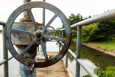 Old rusty floodgate valve photo