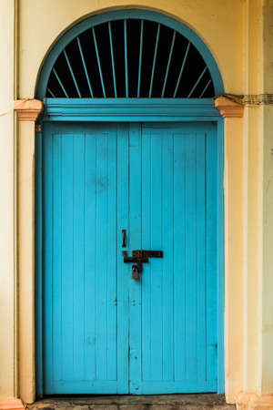 wooden front door to the house, colonial old building style at Nong Khai, Thailand.