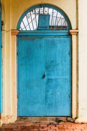 wooden green door on old cement wall photo