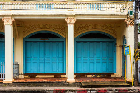 wooden front door to the house, colonial old building style at Nong Khai, Thailand