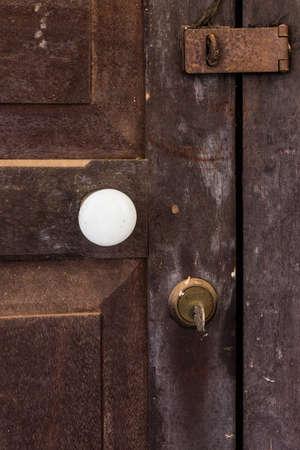 Old wooden door with three lock photo