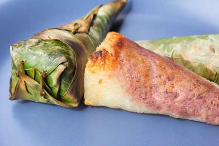Sticky rice roast , wrapped in banana leaves.