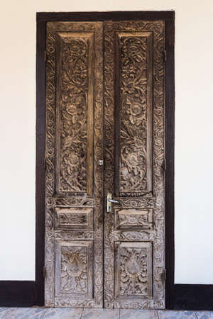 Vintage wooden door on white cement wall