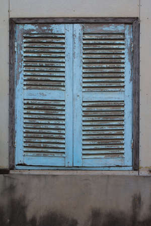 Vintage window on white cement wall
