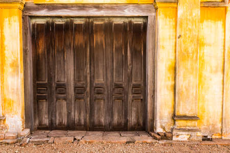 Wooden door to the house, colonial old building style at Tharae, Sakon Nakhon, Thailand  Stock Photo