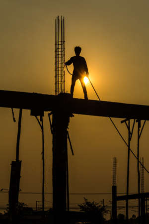 silhouette of constructionworker on constructionsite
