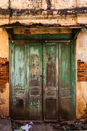 Vintage old door with brick wall
