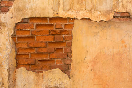 old brick wall with cracked stucco