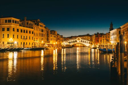 Ponte Rialto and gondola at sunset in Venice, Italy Editorial
