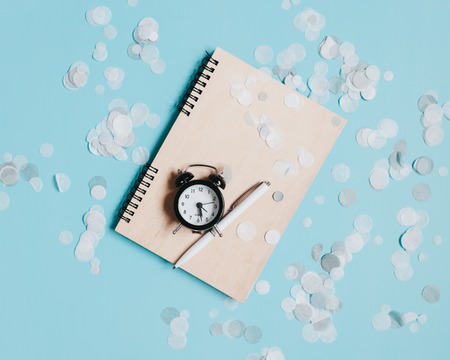 Stylish watch and notebook on the table. The concept of time management