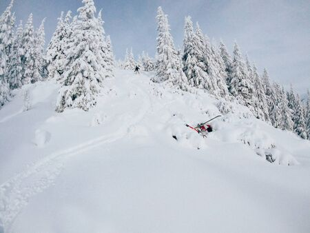 Falling free-raider in the mountains on skis