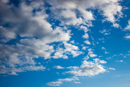 white-grey clouds in the bright blue sky Stock Photo