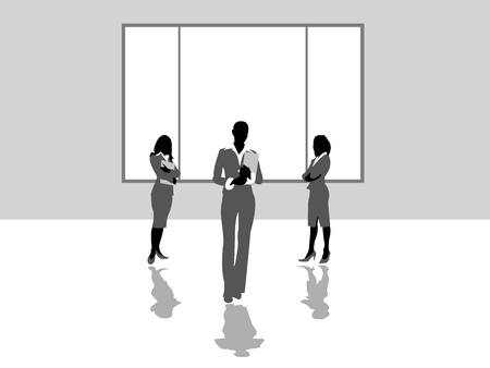three business women standing in front of the Windows in the office