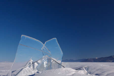 floe: A transparent floe of ice on the lake Baikal with blue sky on the background Stock Photo