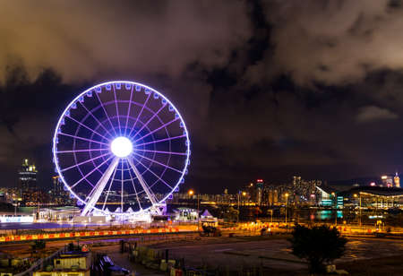 observation wheel: Observation wheel in Hong Kong at night Editorial