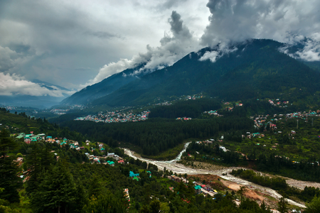 Himalayn valley with city and clouds