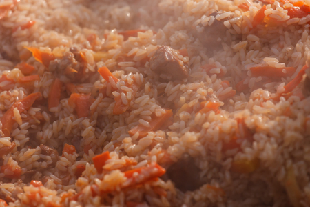Hot Uzbek pilaf with meat and carrot