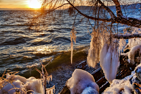 View of Baikal lake at sunset in winter Фото со стока
