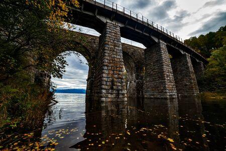 Old archy stone bridge at Transsiberian railway at Baikal lake in autumn