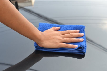 cleaning car using microfiber cloth  Stock Photo