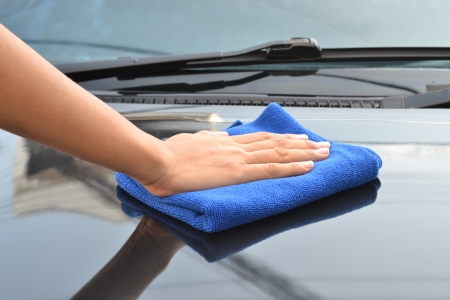 detailing: cleaning car using microfiber cloth  Stock Photo
