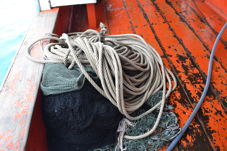 fishing nets and rope on board. photo