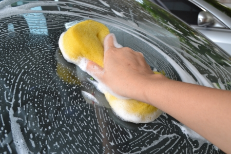 The car wash with a sponge.