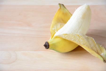 Open banana isolated on wood.