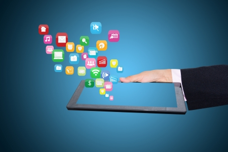 downloading content: Media technology illustration with tablet PC and icons