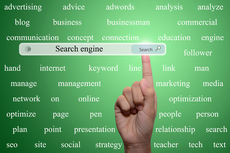 Business and technology, searching system and internet concept - male hand pressing Search Search engine button.  Stock Photo
