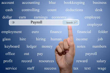 payroll: Business and technology, searching system and internet concept - male hand pressing Search Payroll button.  Stock Photo