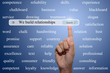 Business and technology, searching system and internet concept - male hand pressing Search  we build relationships button.