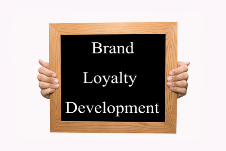 Hand write Brand loyalty development word concept photo