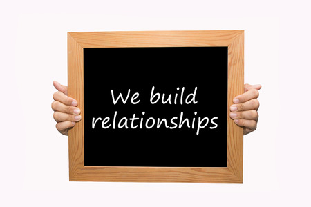 Hand write We build relationships word concept