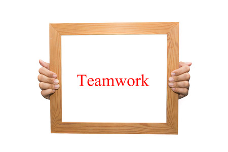 Teamwork on a wooden board Stock Photo - 26883358