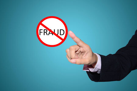 business man pointing Stop fraud sign