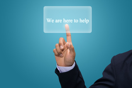 Businessman hand pointing We are here to help
