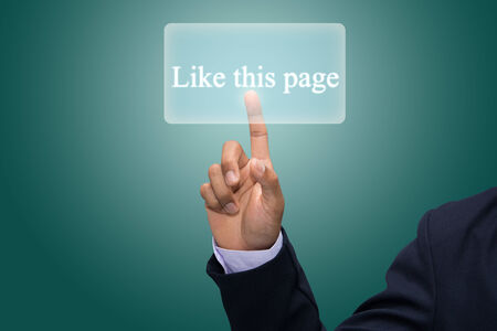 Businessman hand pointing  Like this page  photo