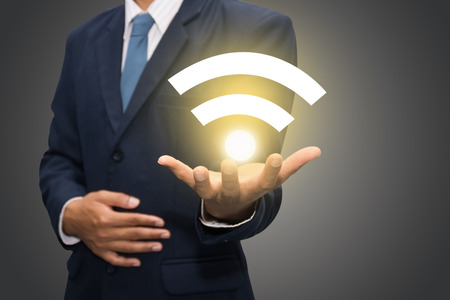 Businessman hand with wifi  photo