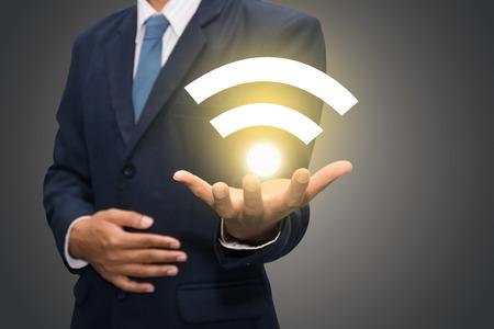 Businessman hand with wifi  Standard-Bild