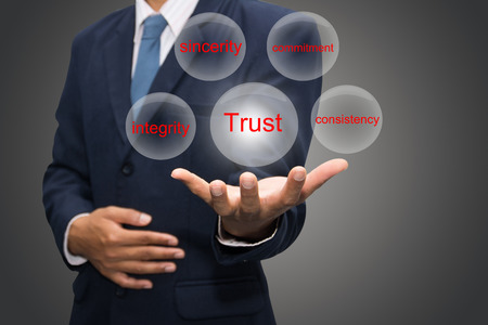 trust: business man writing trust building concept