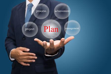 businessman hand write a plan Stock Photo