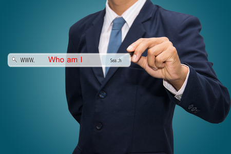 am: Business and technology, searching system and internet concept - male hand pressing Search Who am I button.