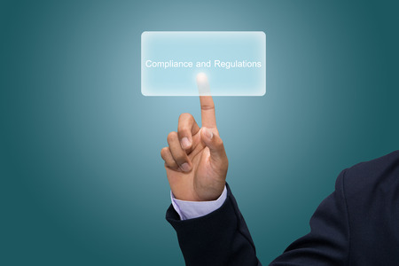 compliance: Businessman hand pointing Compliance and Regulations