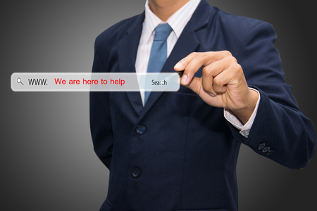 Business and technology, searching system and internet concept - male hand pressing Search We are here to help button.  photo