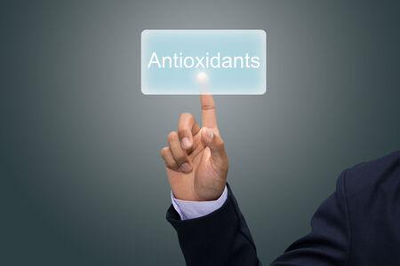 oxidative: Business man hand pointing Antioxidants