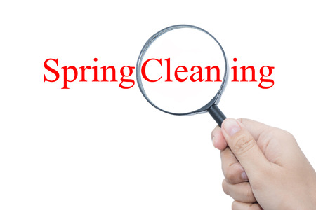 spring cleaning: Hand Showing Spring Cleaning Word Through Magnifying Glass  Stock Photo