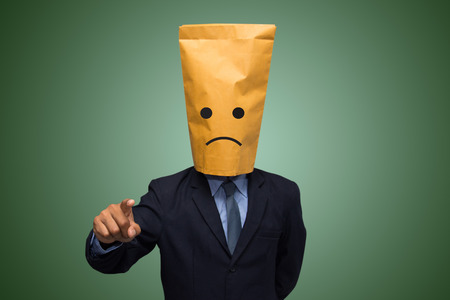 Businessman in ecological paper bag on head.